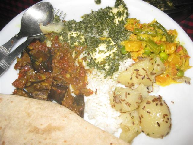 Spoiled for choice, I could never decide what it was I wanted on my plate. Here I have taken a brinjal curry, palak paneer (spinach and cheese), matter paneer (pea & cheese) and aloo jeera (cumin potatoes) with chapatis and rice. Still another 3 choices to go, inevitably I would eat all seven!