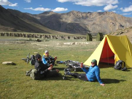 More rewards - superb campsites with beers included - Paul, Graham and Cliff soaking up more than just the landscape!