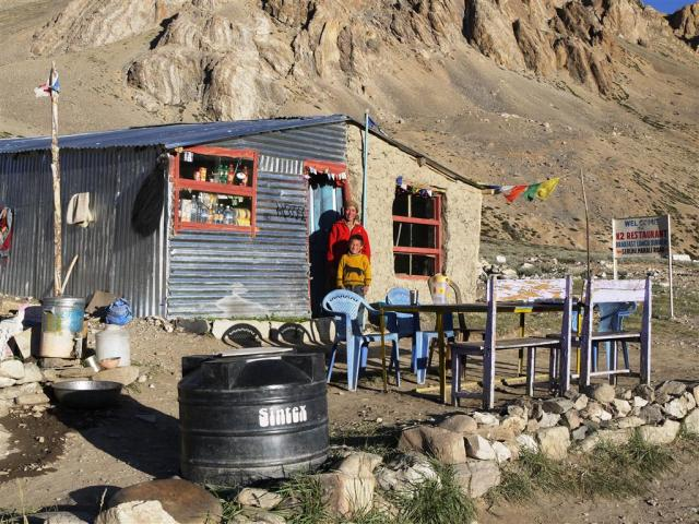 Tsering and Tenzin outside their truckstop cafe 'K2' in 2012.