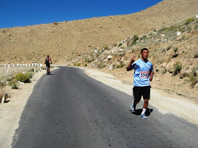 Within the first 20km of riding up we met the first runners coming down, this was now at around 9:30am, these guys still had 20km to go. Here comes Stanzin Dorje, 3rd from the front.