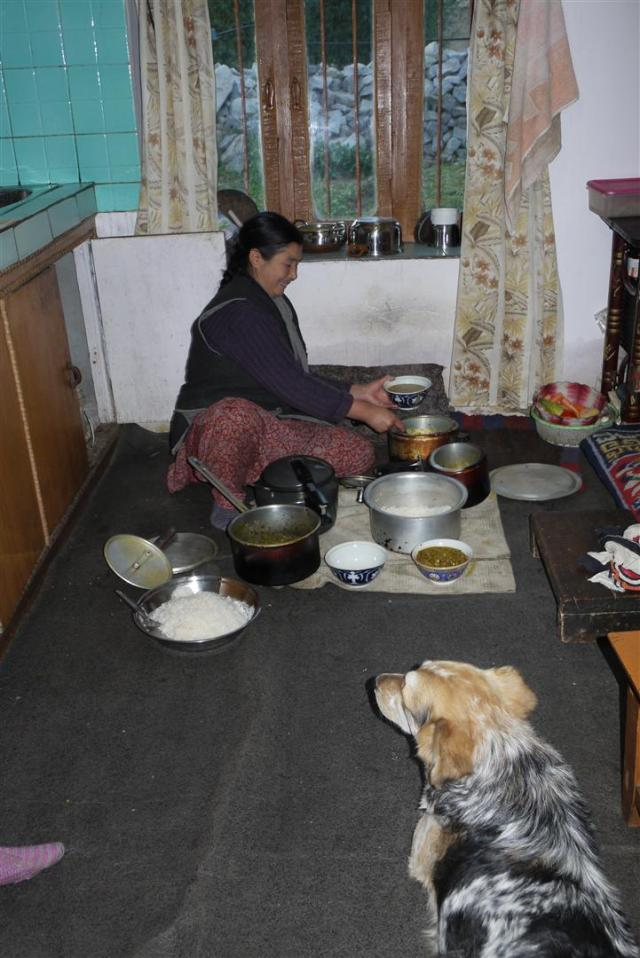 Rumi looks on while Ama Laskit cooks delicious momos, dal and palak paneer.