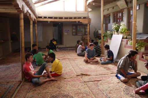 Classrooms are airy and light, no desks, everyone sits on the floor and writes on their laps.