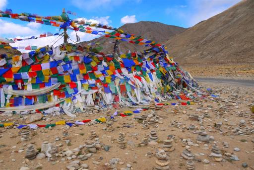 The prayer flag strewn pass before descending to the lakes.