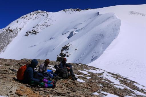 A rest before the final assault - another 200m vertical and another hour of 'cramponing' up this dubious slope filled with holes!